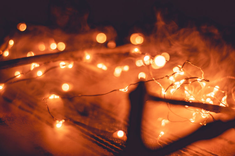 Blurred Motion Burning Celebration Christmas Lights Close-up Decoration Fire Fire - Natural Phenomenon Flame Glowing Heat - Temperature Illuminated Light Light - Natural Phenomenon Lighting Equipment Motion Nature Night No People Orange Color