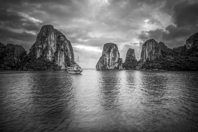 Halong Bay Cloud - Sky Sky Water Scenics - Nature Beauty In Nature Waterfront Sea Tranquil Scene No People Tranquility Nature Rock Formation Rock Idyllic Day Rock - Object Mountain Non-urban Scene Solid Outdoors Stack Rock