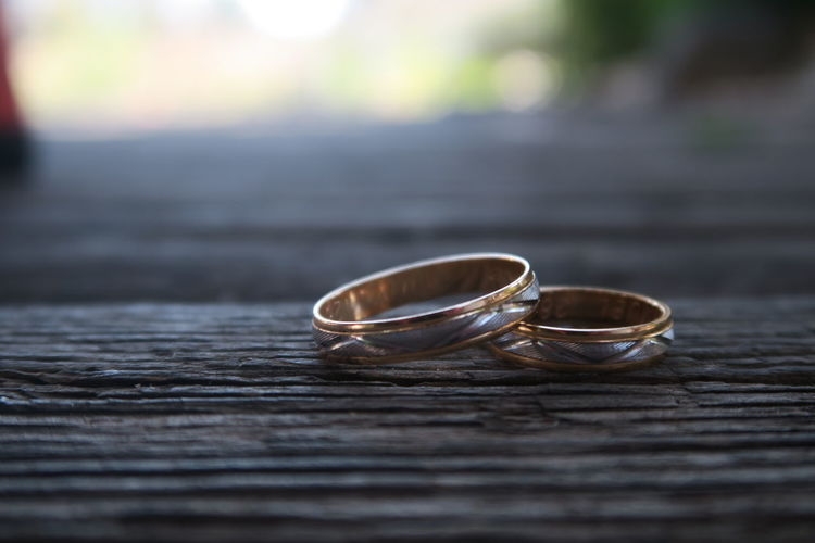 Wedding rings on wooden plank