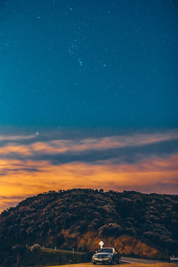 Malibu Sky Scenics - Nature Star - Space Astronomy Beauty In Nature Space Nature Cloud - Sky Mountain No People Environment Night Sunset Galaxy Tranquil Scene Tranquility Built Structure Orange Color Architecture Star Outdoors