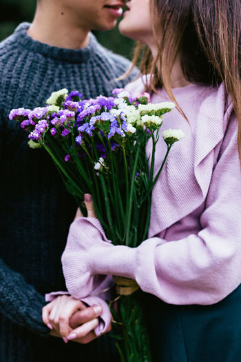 Adult Adults Only Bonding Bouquet Close-up Day Domestic Life Flower Freshness Holding Human Hand Men Midsection Nature Outdoors People Real People Togetherness Two People Women Young Adult Young Women