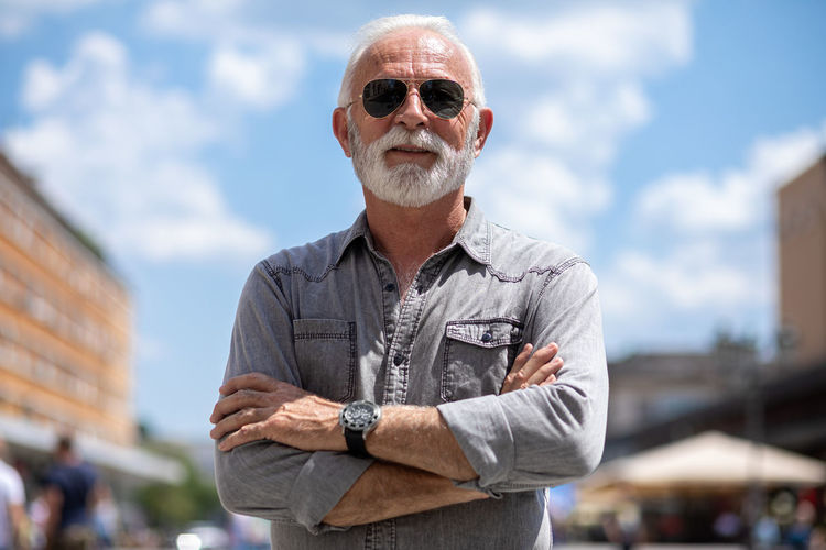 Portrait of man wearing sunglasses standing outdoors