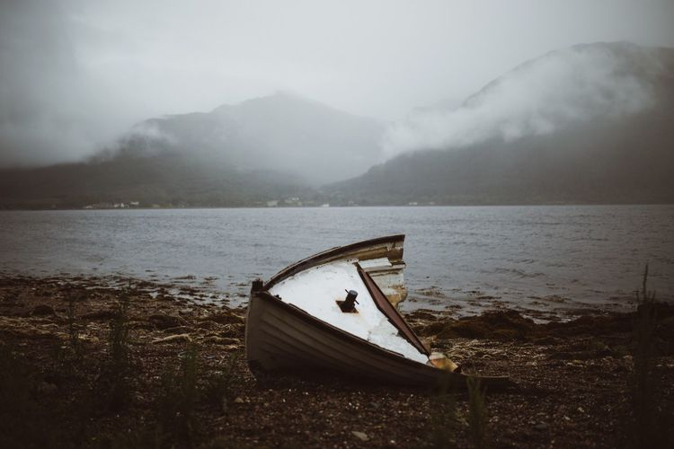 Misty shores. Water Nautical Vessel Nature Weather Fog Tranquility Abandoned No People Beauty In Nature Transportation Outdoors Tranquil Scene Scenics Mountain Lake Moored Cold Temperature Day Sky Beach