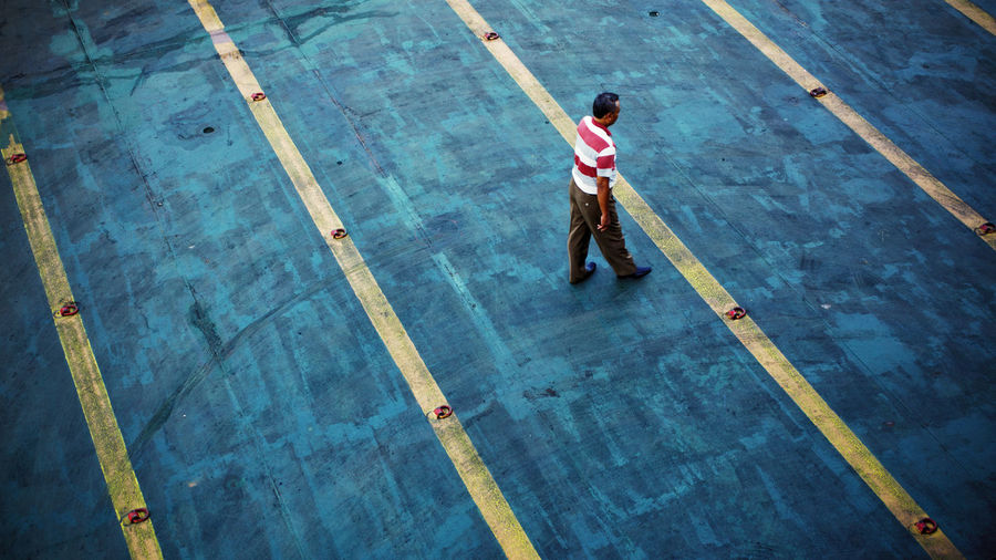 Thoughts come clearly while one walk High Angle View One Person Men Standing Outdoors People Only Men One Man Only Working Stripes Pattern Blue Lines Walk Walking Industrial Industry Manual Worker Occupation Berlin Love