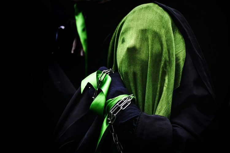 Close-up of person covering face with scarf