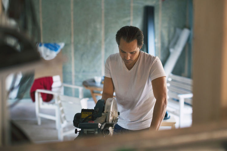 Man working on table at home
