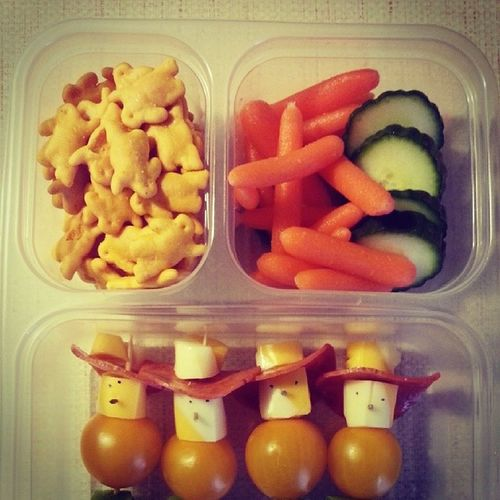 Mason's school lunch. Mom made little cowboys out of cheese, tomatoes and pepperoni. Kpfunism Healthylunch