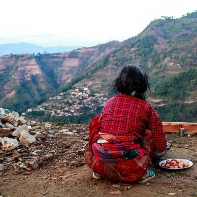 A women peels potatoes while looking at the destroyed village.. Nepalearthquake2015 Nepal Gamphedanda Yellowhouse Switchback Colorsofnepal Staystrong Dktm