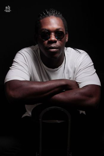 Portrait Looking At Camera Studio Shot One Person Front View Adult Black Background Men Mature Adult Arms Crossed Sitting Males  Glasses Mature Men Sunglasses Casual Clothing