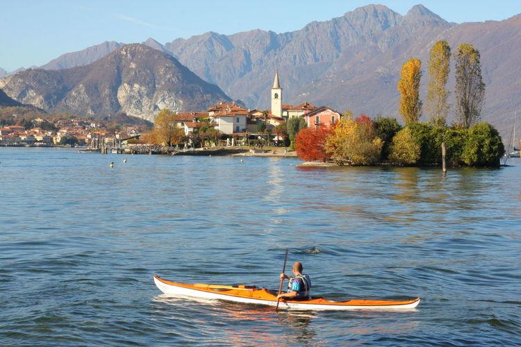 Man kayaking on lake maggiore