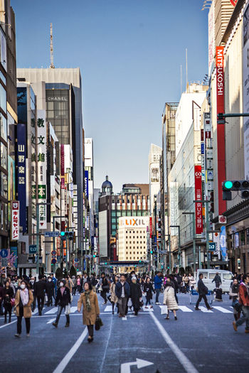 Ginza tokyo Japan Architecture Built Structure City City Life Clear Sky Commercial Downtown Ginza Large Group Of People Shopping Street Walking Building Exterior Person Tokyo Travel Destinations Vertical Composition