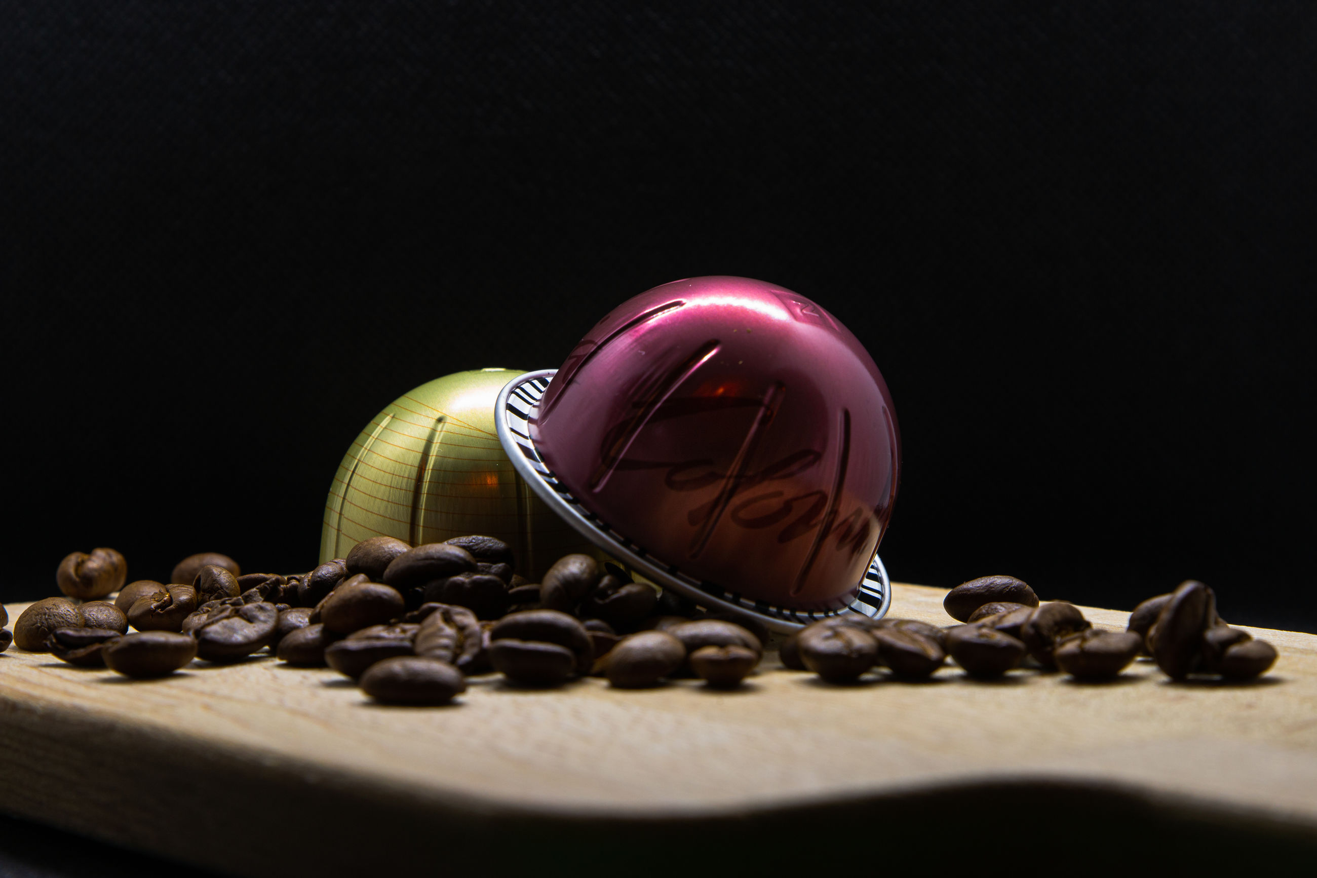 still life, close-up, indoors, black background, no people, studio shot, food and drink, sphere, food, selective focus, pink color, copy space, table, large group of objects, freshness, roasted coffee bean, indulgence, sweet food, creativity, design, surface level