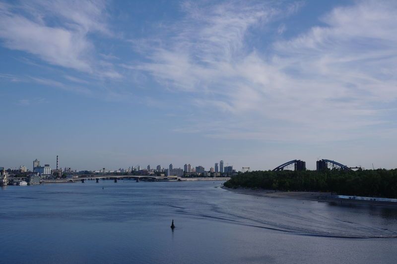 Morning on Dnieper with blue sky and calm water surface Sky Building Exterior Water Built Structure City River Waterfront Cityscape Building Outdoors Cloud - Sky Architecture