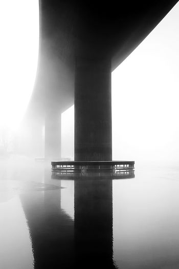 Into the mist Backgrounds Composition Geometry Angles And Lines Road To Nowhere Fade To White Into Nothing  Misty Morning Mist Foggy Day Fog Black And White Graphic Årstaviken Lake Minimalism Architecture Built Structure Water Bridge - Man Made Structure Waterfront Reflection No People River Outdoors Travel Destinations Symmetry Day City The Graphic City