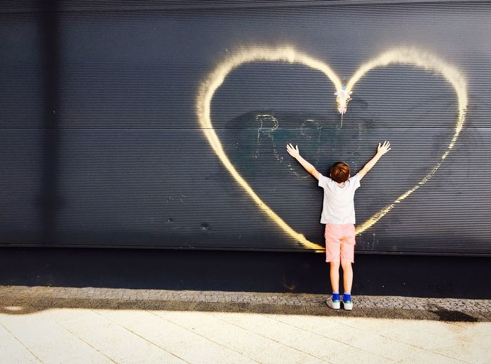 Love sweet love Streetphotography Street Photography Street Grafitti Full Length Shadow Wall - Building Feature Kids Front View Outdoors Day Heart Casual Clothing Iphonephotography Arms Raised Boy Children Berlin Colorful Colors Kids Being Kids Standing Grey Wall My Year My View