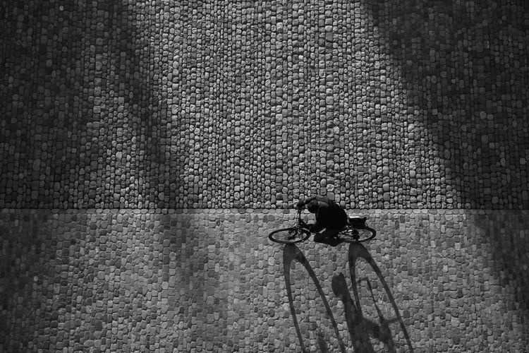 Directly Above Shot Of Man Riding Bicycle On Street