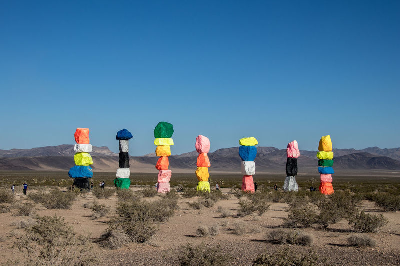 seven magic mountains art installation outside of Las Vegas Nevada Sky Clear Sky Copy Space Blue Nature Multi Colored Day Environment Land Group Of People Real People Sunlight Protection Security Men Side By Side Leisure Activity Women Safety Outdoors 7 Magic Mountains Seven Magic Mountains Las Vegas NV Art Installation