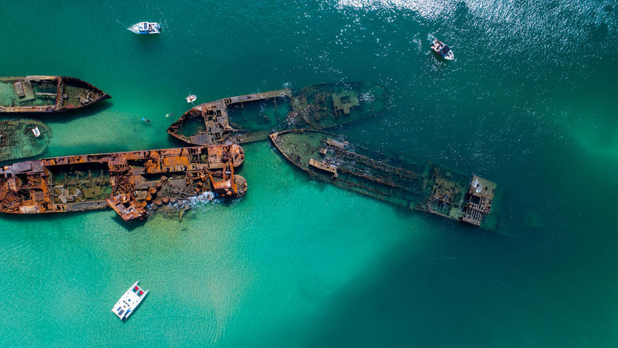 Aerial Footage of the old whaling ships at Tangalooma on Moreton Island, Queenslad Beauty In Nature Nautical Vessel Transportation Mode Of Transportation Turquoise Colored Water Ship High Angle View Sky Nature Aerial View Waterfront Drone  Drone Photography Tranquility Moreton Bay Fig Tree Queensland Australia Outdoors