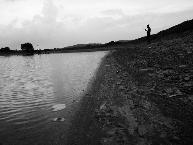 Sky One Person Cloud - Sky Beach Vacations Outdoors People One Man Only Water Only Men Day Nature Adult Full Length Adults Only Beauty In Nature Blackandwhite Ilustration Young Adult