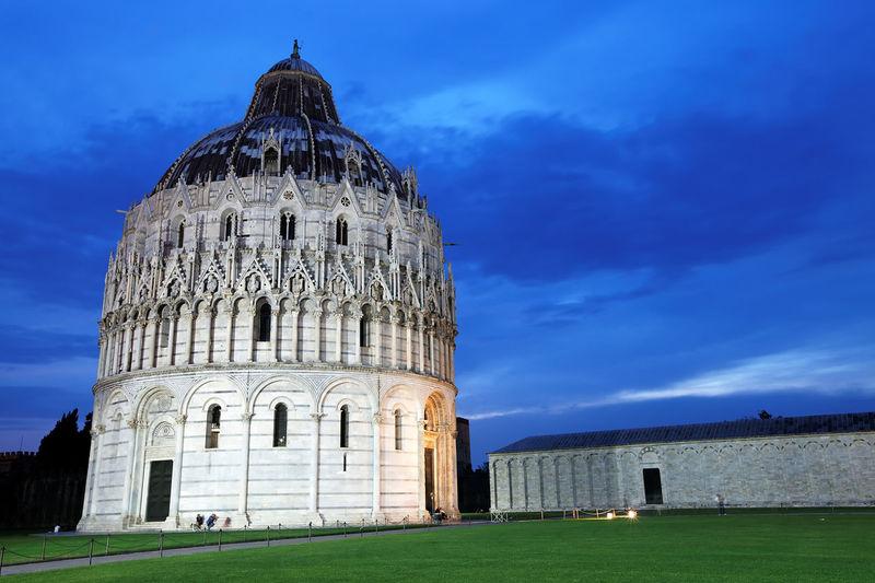 Pisa baptistery against blue sky at dusk