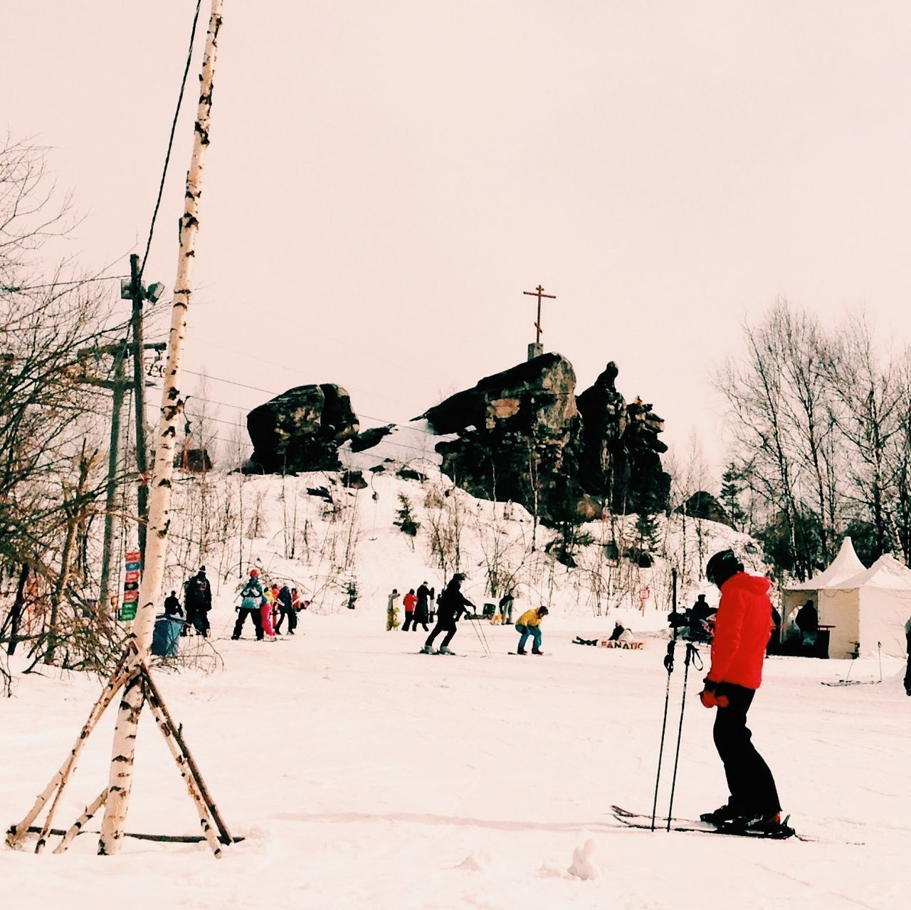 People Skiing On Snowy Mountain Against Sky