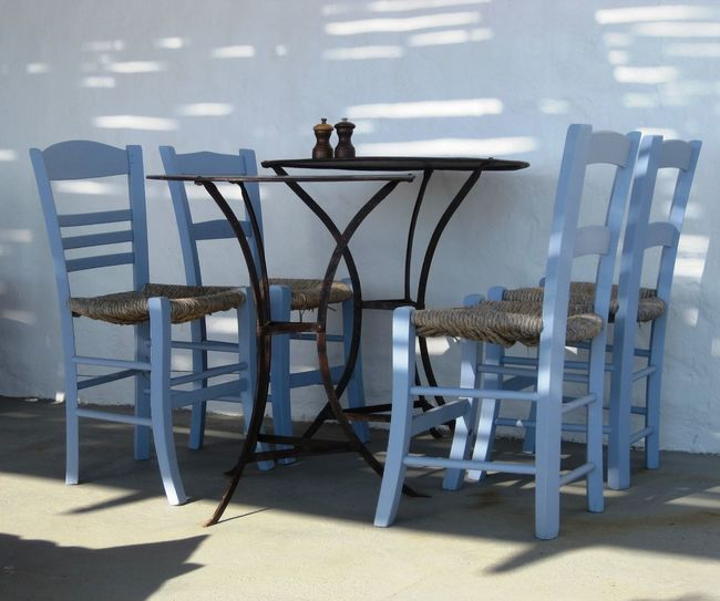 Metal Table with Four Blue Chairs Blue Blue Painted Chairs Chair Chair Day Empty Four Chairs Greek Style Metal Table No People Table Taking Photos Wooden Chairs The Architect - 2018 EyeEm Awards