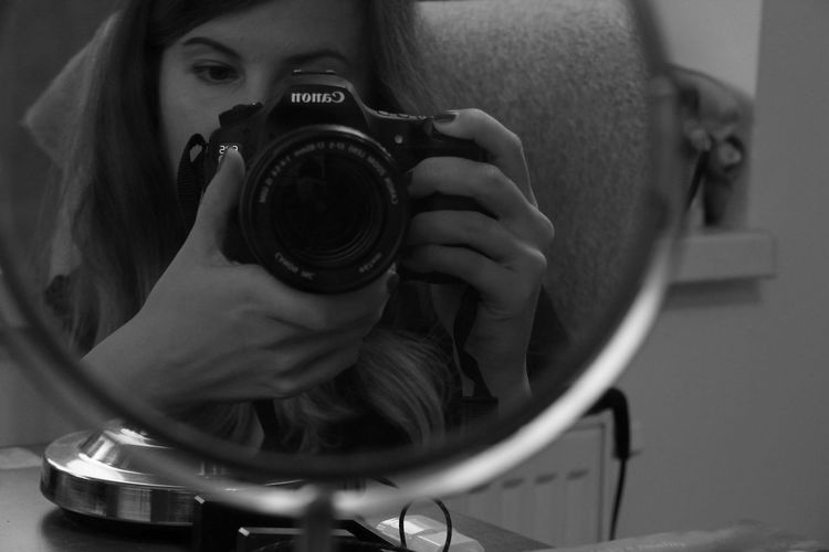 The girl behind the camera one year later This Is Natural Beauty Camera - Photographic Equipment One Person Portrait Leisure Activity Photographer Real People Photographing Technology Digital Camera Lifestyles Blackandwhite Occupation Activity Photographic Equipment Indoors  Camera Front View Holding Personal Perspective Looking Through An Object 2018 In One Photograph