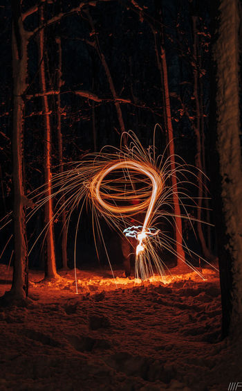 Long Exposure Night Wire Wool Motion Blurred Motion Glowing Fire Burning Illuminated Spinning Standing Sign Fire - Natural Phenomenon One Person Warning Sign Real People Land Tree Communication Speed Skill  Outdoors Light Trail Sparks