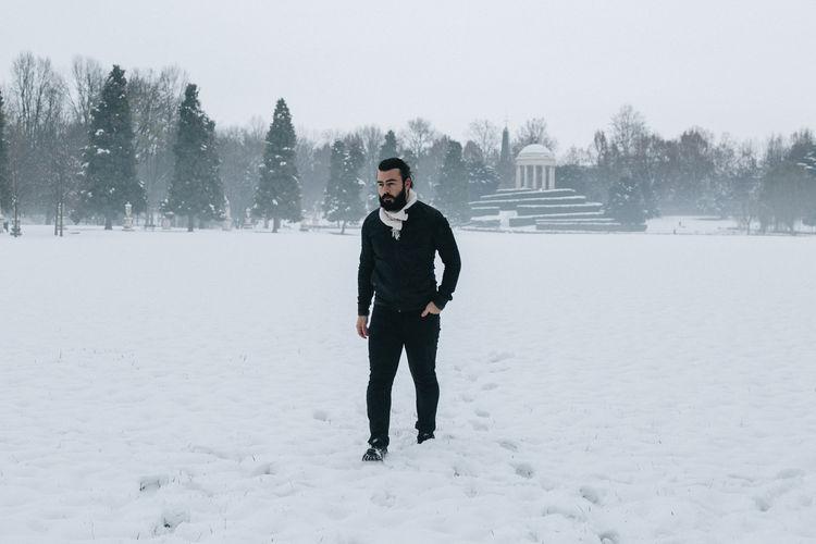 Full length of man walking on snow field