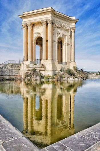 Reflection Water Architecture Travel Destinations Cloud - Sky History Monument Built Structure Sky Politics And Government Architectural Column Outdoors Vacations Day No People Building Exterior