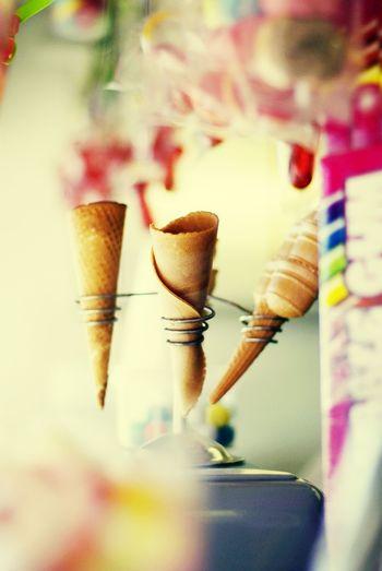 Ice cream cones in spiral holder at shop