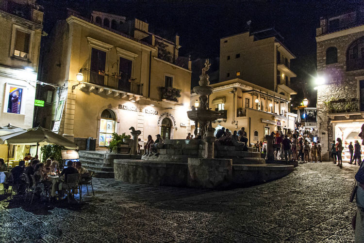 La noche en Taormina Italia Sicilia Taormina Viajes  The Traveler - 2019 EyeEm Awards The Street Photographer - 2019 EyeEm Awards Night Architecture Built Structure Group Of People Illuminated Building Exterior Large Group Of People Crowd Women Real People City Men Adult Lifestyles Building Street History The Past Nature Outdoors