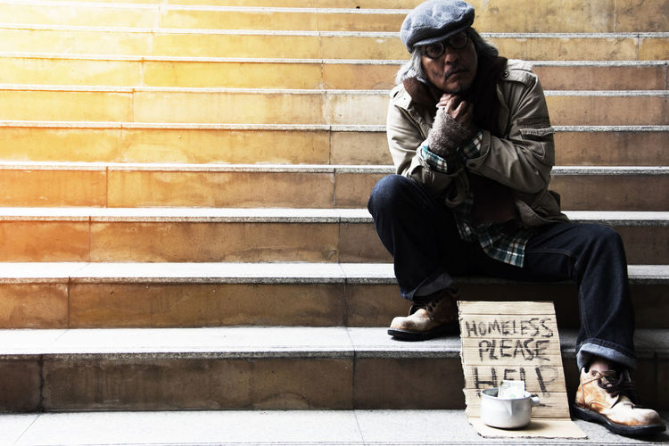 Homeless man on walkway street, Homeless concept. People Street Alone City Homeless People Hope Poor  Day Help Helpless Homeless Homeless Family Homeless Person Homelessman Homelessness  Men Money One Man Only One Person Outdoors Poorpeople Problem Sad Sitting Street Street Photography