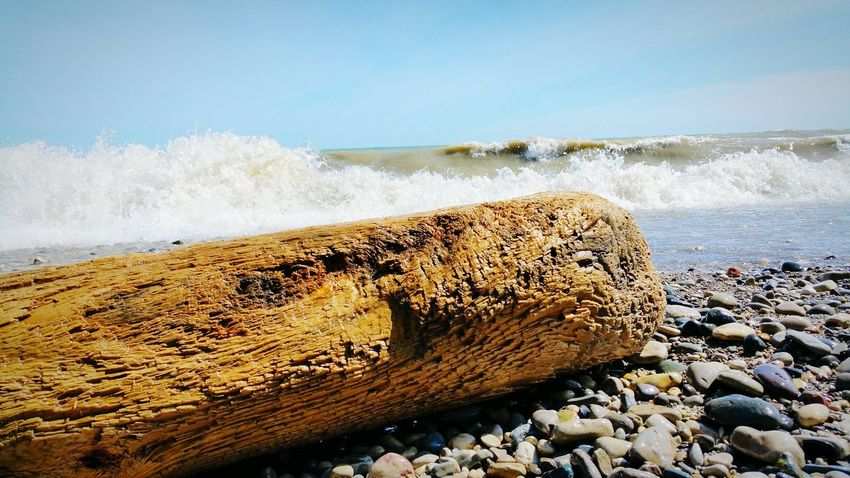 EyeEm Selects Great Lakes Lake Michigan Beach Sea Water Nature Motion Pebble Outdoors Day Sand Rock - Object No People Wave Horizon Over Water Power In Nature Beauty In Nature Sky Crash Close-up Pebble Beach