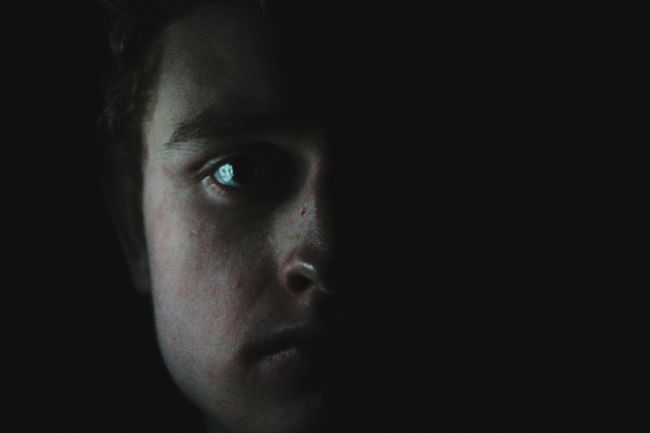 Dark Studio Shot Human Face Human Eye Young Adult Portrait Human Body Part Looking At Camera Spooky One Person Adult Black Background People Close-up Adults Only Eyebrow