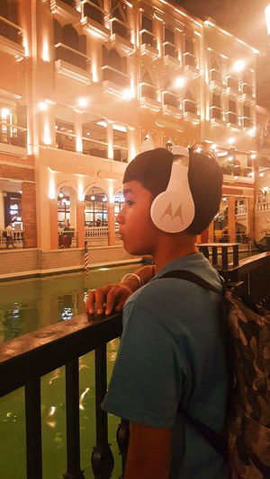 Great Views Tourist Attraction  Water Reflections Beautiful Sites Boy Boys Building Casual Clothing Childhood Headset Illuminated Leisure Activity Leisure Time One Boy Only One Person Perfect View Railings Sight Seeing Standing Tourism Tourist Destination Water