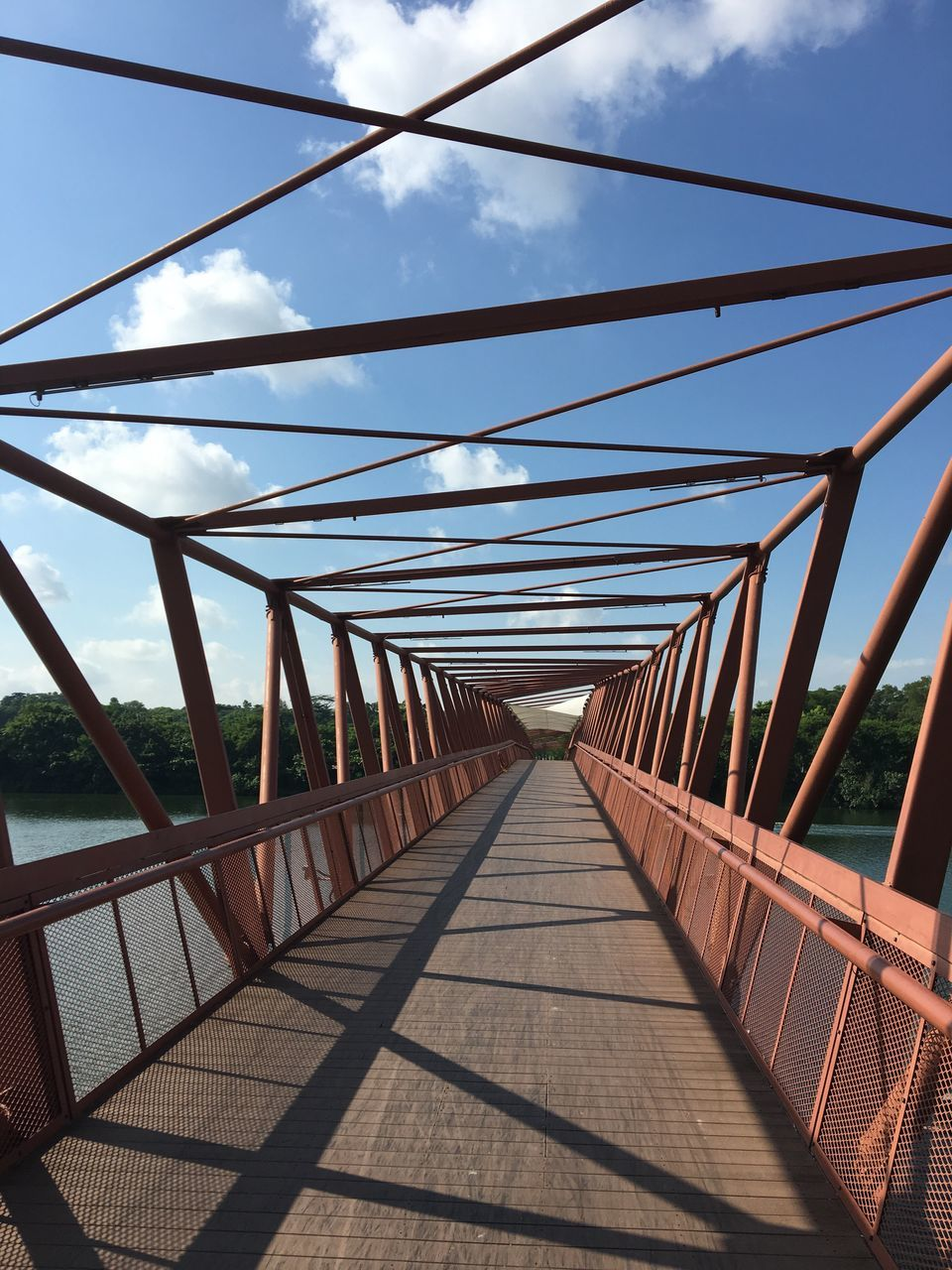 connection, railing, bridge - man made structure, the way forward, day, footbridge, cable, outdoors, sky, no people, nature