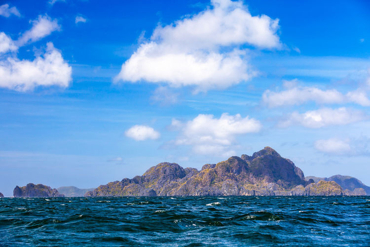 Islands of the Bacuit Archipelago Palawan Philippines Bacuit Archipel Sky Water Sea Scenics - Nature Beauty In Nature Cloud - Sky Waterfront Blue Day No People Mountain Nature Idyllic Outdoors Tropical Climate Seascape Landscape Ocean Scenics Paradise El Nido