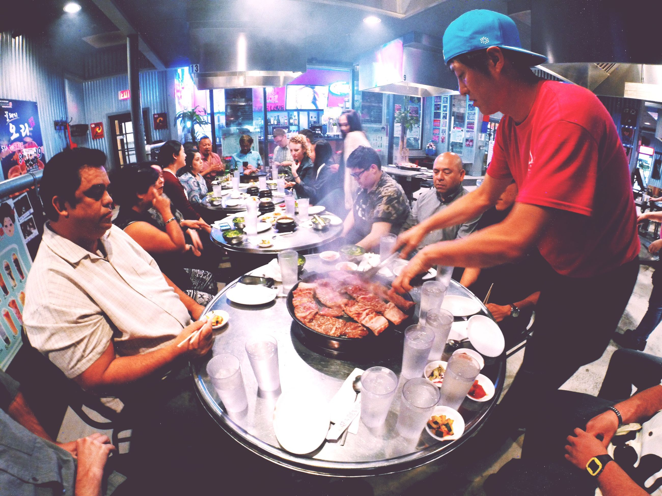 food and drink, food, freshness, indoors, lifestyles, men, preparation, holding, cooking, leisure activity, meat, occupation, heat - temperature, preparing food, healthy eating, casual clothing, person