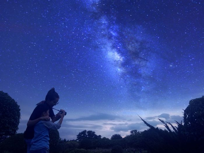 Mother With Son Against Star Field