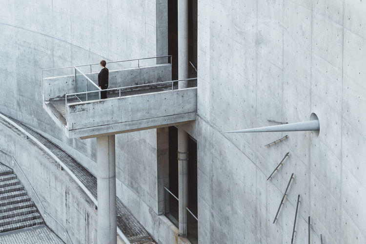 The Architect - 2018 EyeEm Awards Adult Architecture Building Building Exterior Built Structure Business Person Day Glass - Material Lifestyles Men One Person Outdoors Railing Real People Staircase Standing Wall Wall - Building Feature Window