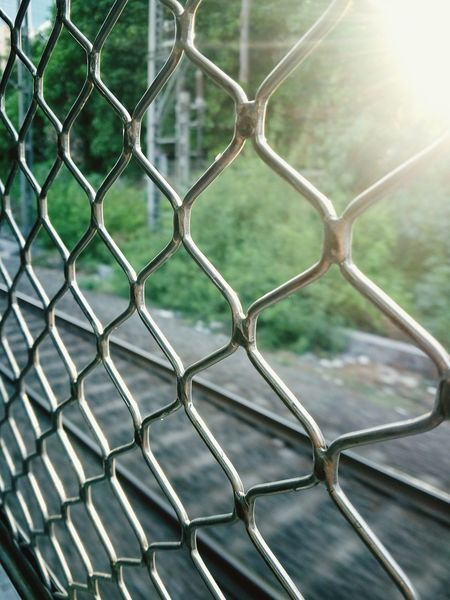 Through the windows of a local train in Mumbai Chainlink Fence Metal No People Full Frame Sky Nature Close-up Outdoors Pattern Safety Protection Backgrounds Day Travel Mumbai Local Train Art Is Everywhere Indiatraveller Streetphoto_color Morning Light The Street Photographer - 2017 EyeEm Awards The Great Outdoors - 2017 EyeEm Awards Real Lives Daily Life Sunlight Lensflare