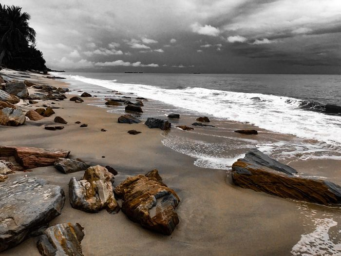 Sea waves attacking rocky beach before big storm in monotone color Sea Water Sky Beach Nature Tranquil Scene Tranquility Rock - Object Cloud - Sky Horizon Over Water Beauty In Nature Scenics No People Outdoors Day Sand Shore Storm Cloud Blackandwhite Monochrome Ocean Tropical Thailand Landscape Stone