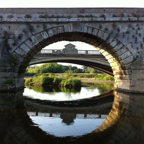 Arch bridge over river