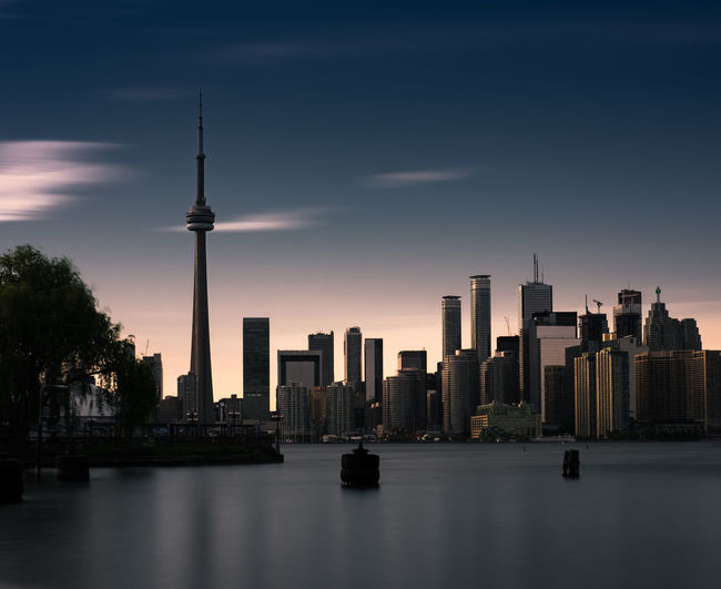 Captured from the Toronto Island. It's one of the best views of the city. CN Tower Architecture Building Exterior Built Structure City Cityscape Long Exposure Sky Skyscraper Tall - High Tourism Tower Travel Travel Destinations Water Waterfront