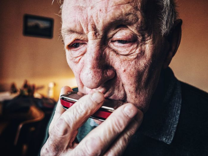 Old man playing harmonica. EyeEm Best Shots Faces Of EyeEm Face EyeEm Best Shots Serious Seriousface Music Musical Instrument Old Age Senior Men Human Hand Portrait Men Human Face Headshot Shock Looking At Camera Senior Adult Facial Expression Making A Face Analogue Sound The Portraitist - 2019 EyeEm Awards