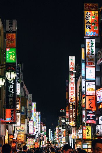 Japan Illuminated Architecture Built Structure Night Building Exterior City Communication No People Low Angle View Advertisement Text Sky Building Outdoors Clear Sky Nature Travel Destinations Sign Billboard Skyscraper