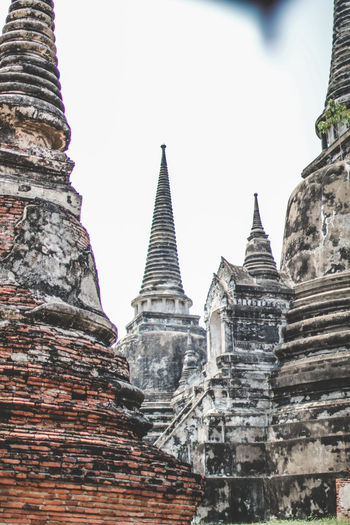 ON 26 May 2019,The old famous temple in Thailand world heritage / Wat Phrasrisanphet Architecture Built Structure Place Of Worship Religion Belief Spirituality Building Building Exterior Travel Destinations Sky History The Past Low Angle View Travel Tourism Clear Sky No People Day Outdoors Spire  Ancient Civilization Archaeology Old Culture Ancient Landmark Architecture Travel Pagoda Heritage Buddhism Vintage Historical Buddhist Traditional Thailand Ayutthaya Tourist Thailand Culture Unesco Structure Historic Temples Sunlight Old Temple Thailand Travel Asian  Brick Brick Wall Stupa