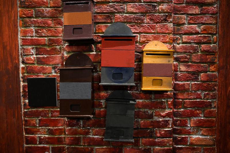 Close-up of mailbox against brick wall