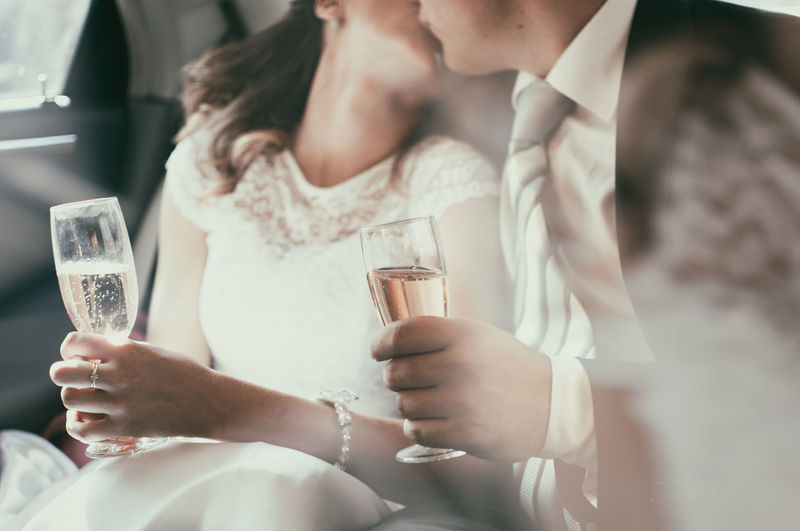 Bride And Groom Holding Champaign Bride And Groom In A Car Bride And Groom Kissing Bride And Groom With Wine Glasses Champagne Wedding Day